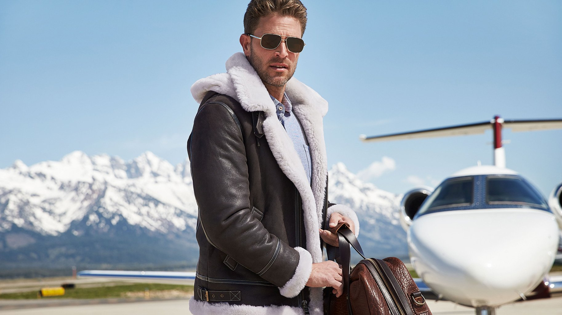 Man in Bomber Jacket with small airplane